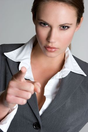 furious: Businesswoman Pointing Finger