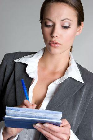Businessperson Writing Checks Stock Photo - 4376551