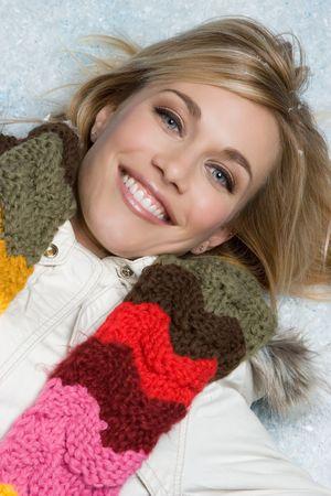 warm jacket: Smiling Snow Girl Stock Photo