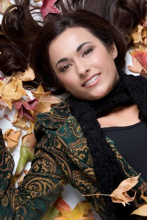 Autumn Girl in Leaves Stock Photo