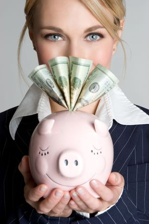 Woman With Piggy Bank photo