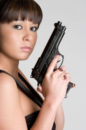 korean ethnicity: Asian Woman With Gun