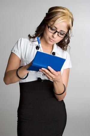 Businesswoman Writing Checks Stock Photo - 4894007