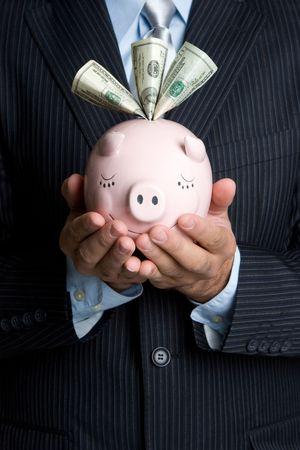 Man Holding Piggy Bank Stock Photo - 4573382