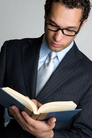 Businessman Reading Book Stock Photo
