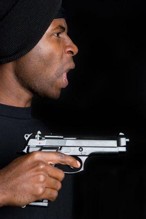 Gangster Holding Gun Stock Photo - 4593701