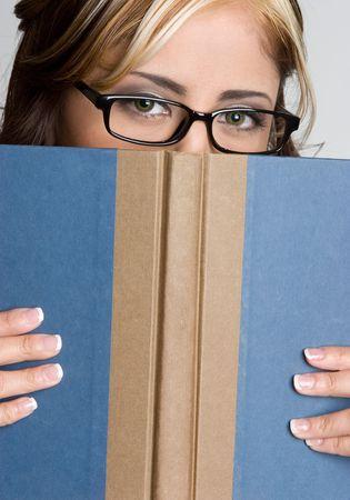 Woman Hiding Behind Book Stock Photo