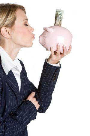 Woman Kissing Piggy Bank Stock Photo - 4636579