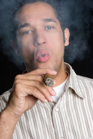 Man Blowing Cigar Smoke Stock Photo - 4652922