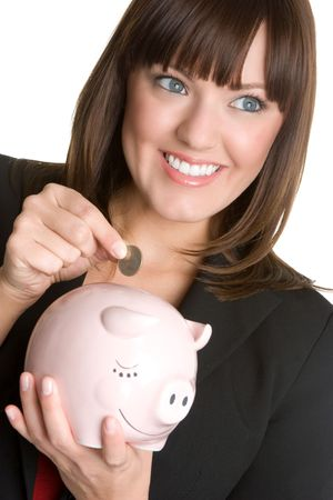Woman Putting Coin in Piggybank Stock Photo - 4661610