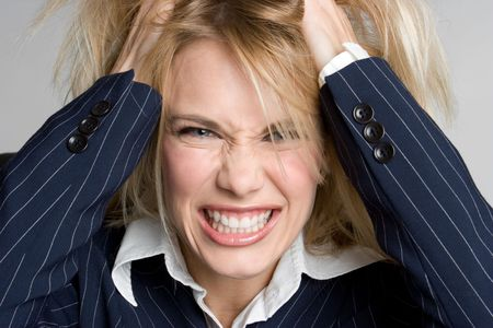 pulling hair: Stressed Businesswoman