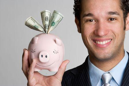Człowiek Holding Piggy Bank Zdjęcie Seryjne