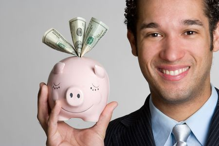 piggybanks: Man Holding Piggy Bank