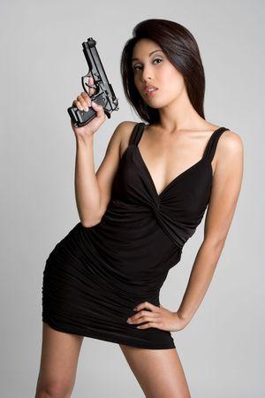 Asian Gun Woman Imagens