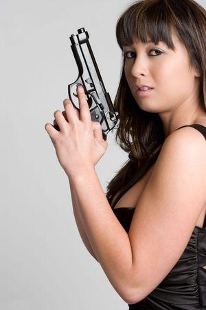 Sexy Woman Holding Gun photo
