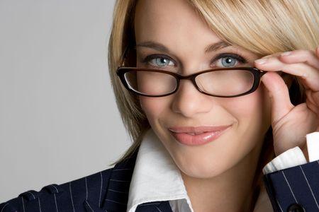 smirking: Beautiful Woman Wearing Glasses