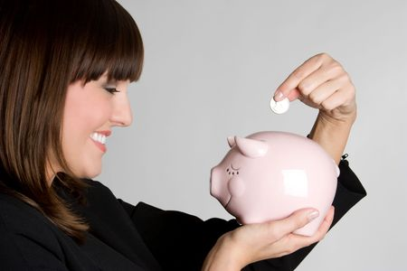 Woman Putting Coin in Piggy Bank Stock Photo - 4835746