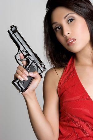 Woman Holding Gun Stock Photo - 4870274