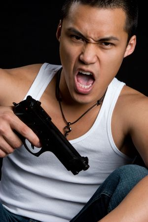Asian Man Holding Gun Stock Photo - 4918209