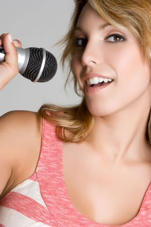Woman Singing into Microphone photo