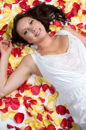 Woman Laying in Rose Petals Stock Photo - 4970107