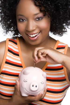 Girl Dropping Coin in Piggybank Stock Photo - 5020826
