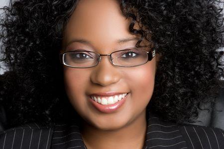 woman wearing glasses: Black Businesswoman Smiling