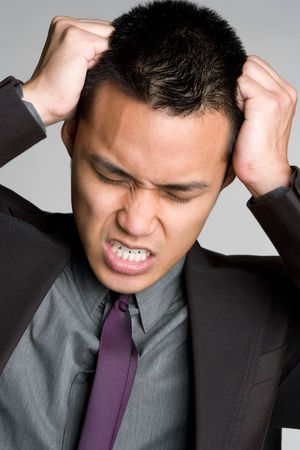 pull out: Frustrated Asian Businessman LANG_EVOIMAGES