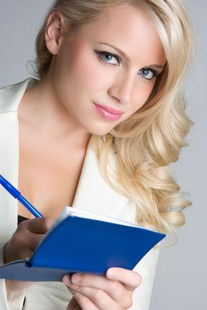 Blond Businesswoman Writing Checks Stok Fotoğraf