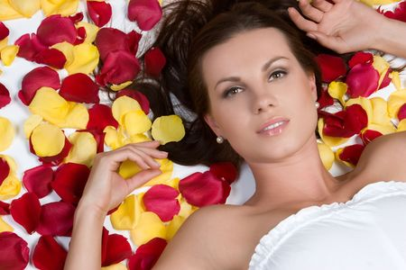 woman laying: Woman Laying in Rose Petals LANG_EVOIMAGES