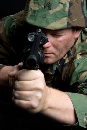 Army Man Pointing Gun photo