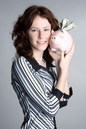 Girl Holding Piggybank Stock Photo - 5218576