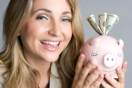 Woman Holding Piggy Bank Stock Photo - 5219397