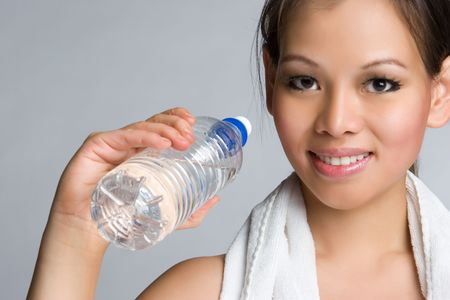 sweating: Asian Holding Water Bottle