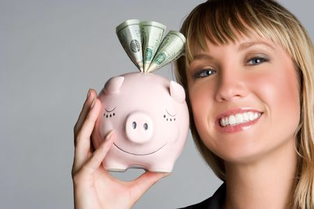 Woman Holding Piggybank Stock Photo - 5372631