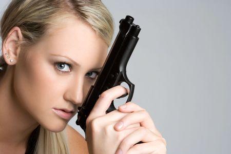 Blond Gun Woman Imagens