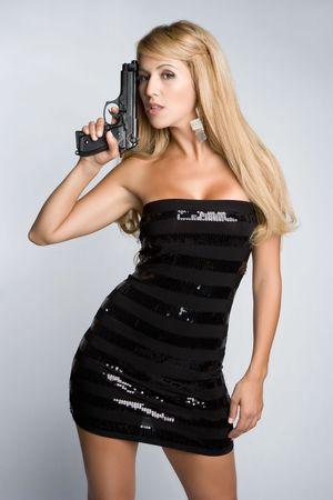 blonde hispanic: Latina Woman Holding Gun
