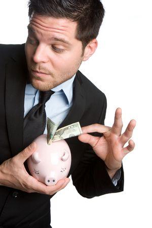 stealing money: Man Stealing Money From Piggybank LANG_EVOIMAGES