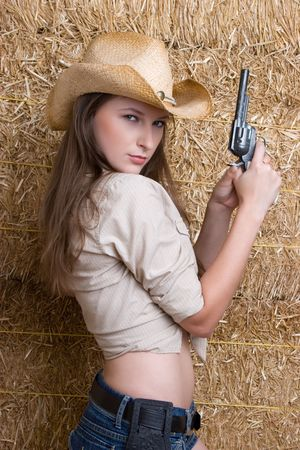 Cowgirl With Gun Stock Photo