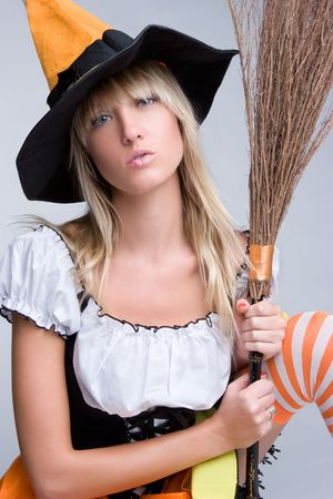 Witch Holding Broom Stock Photo - 5559739