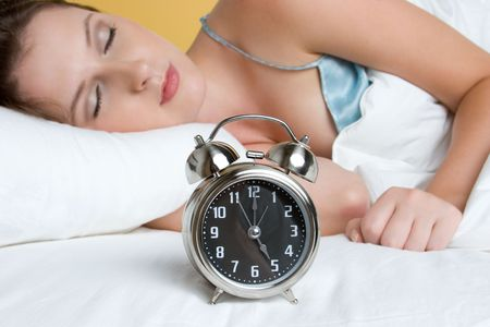 Woman Sleeping With Clock Stock Photo - 5591231