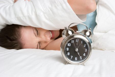 Woman Waking Up to Alarm Stock Photo - 5591232