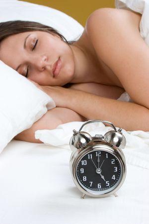 Sleeping Woman With Alarm Clock Stock Photo - 5634196