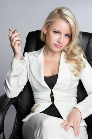 gorgeous businesswoman: Woman Holding Cell Phone