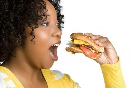 Woman Eating Burger Stock Photo - 5626364