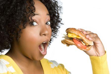 adult sandwich: Woman Eating Hamburger LANG_EVOIMAGES