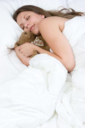 Woman Sleeping With Teddy Bear Stock Photo - 5747531