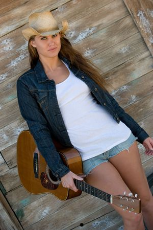 Country Girl Holding Guitar photo