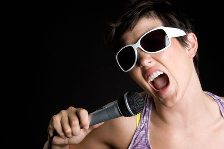 Girl Singing into Microphone Stock Photo - 5760808