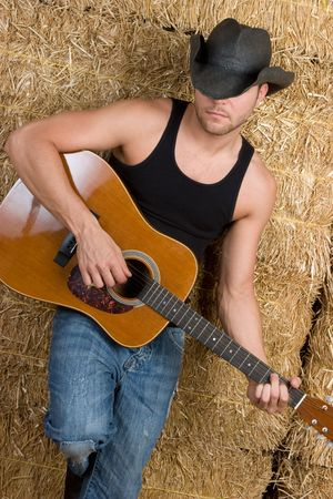 Country Boy Playing Guitar Stock Photo - 5760815